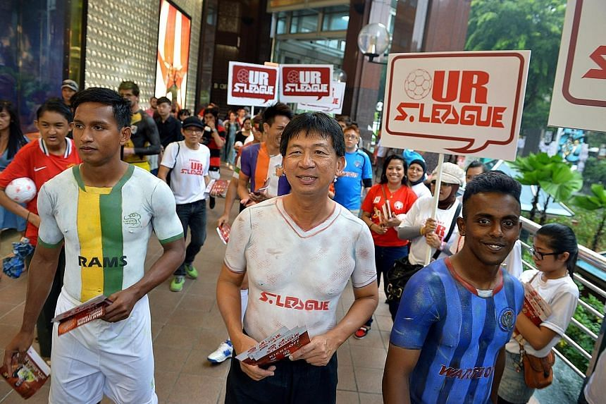 S-League CEO Lim Chin (centre) has participated in many promotional drives to boost the league, such as donning body paint with S-League players for a fan drive event at Orchard Road in 2013.