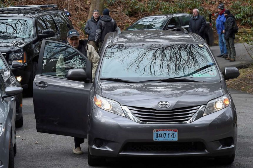 A vehicle with diplomatic license plates departs from a Russian compound in Upper Brookville, Long Island, New York, Dec 30, 2016.