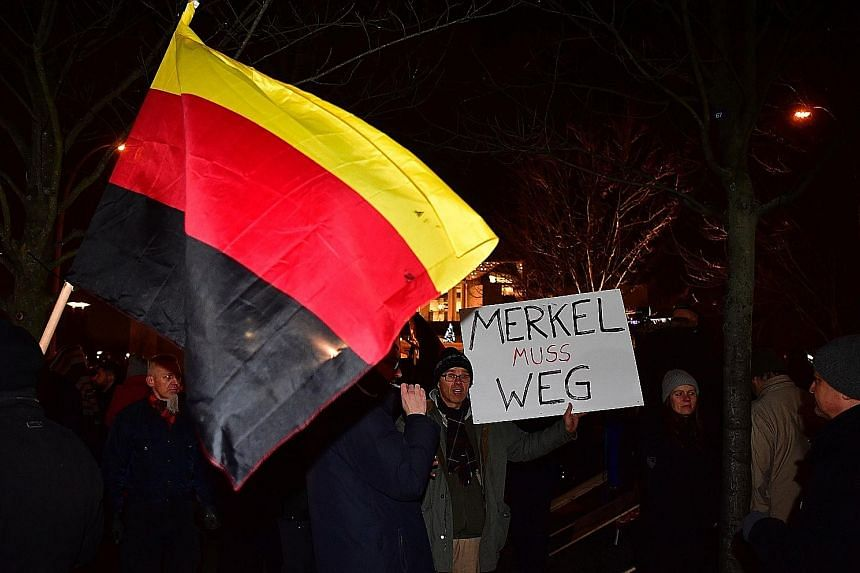 Sympathisers of German populist party AfD calling for Chancellor Merkel to leave during a protest after the attack at the Christmas market in Berlin last month. The EU today is more vulnerable to external aggression than it has been in 25 years, and