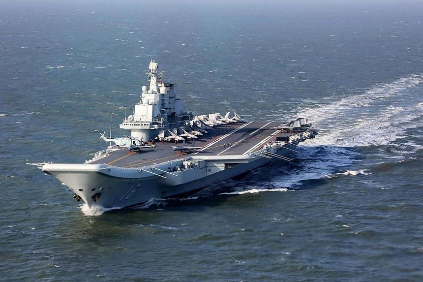China's only aircraft carrier, Liaoning, sailing during military drills in the Pacific, on Dec 24, 2016 .