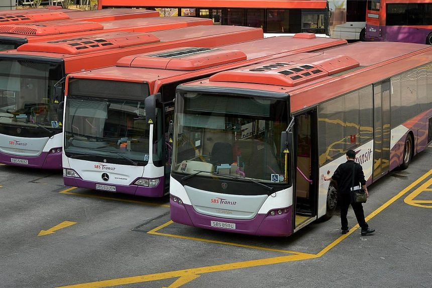 File photograph of a SBS Transit bus driver closing the doors of the bus as he ends his shift in the afternoon at Toa Payoh Interchange.