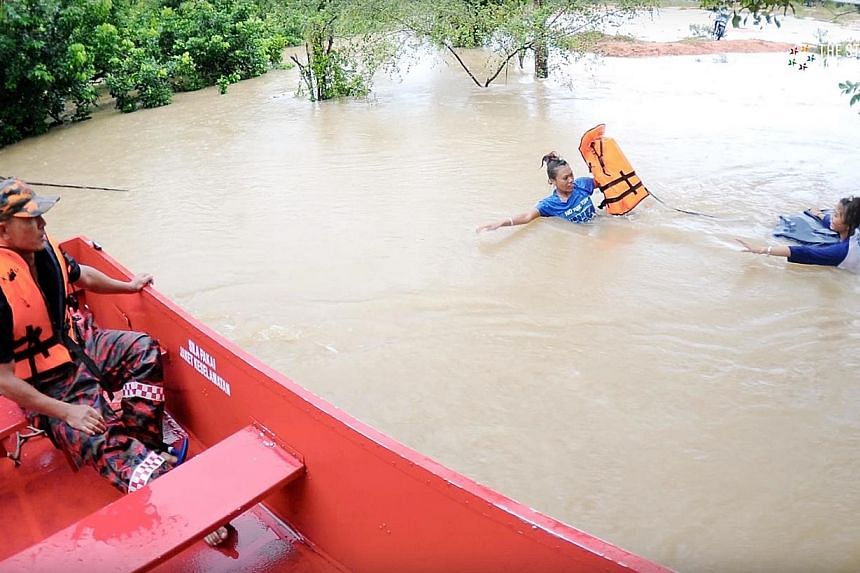 The floods in Malaysia's east coast, which some describe as the worst in 30 years, forcing the evacuation of thousands in Terengganu and Kelantan.