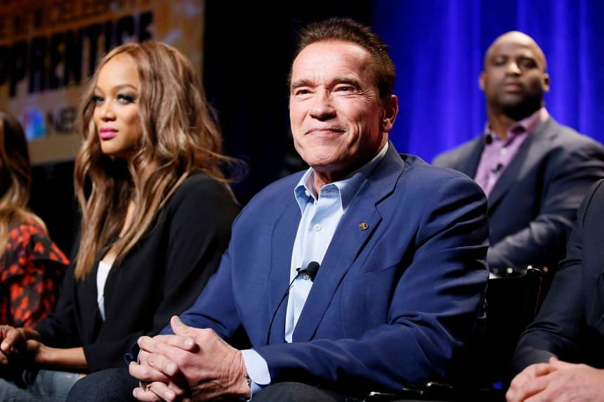 Host Arnold Schwarzenegger (right) and Tyra Banks participate in a panel for The New Celebrity Apprentice in Universal City, California on Dec 9, 2016.