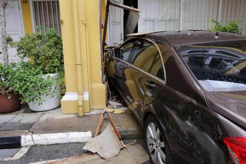 A car rammed into a two-storey shophouse opposite the New Majestic Hotel.