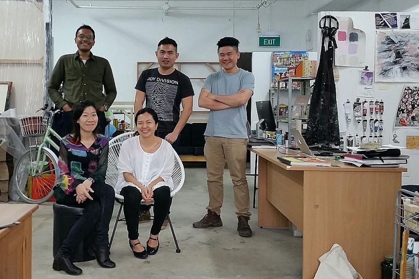Artists Soh Choi Yin (seated, left), Betty Susiarjo, Hilmi Johandi (standing from left), Simon Ng and Ezekiel Wong at their studio in Ubi.