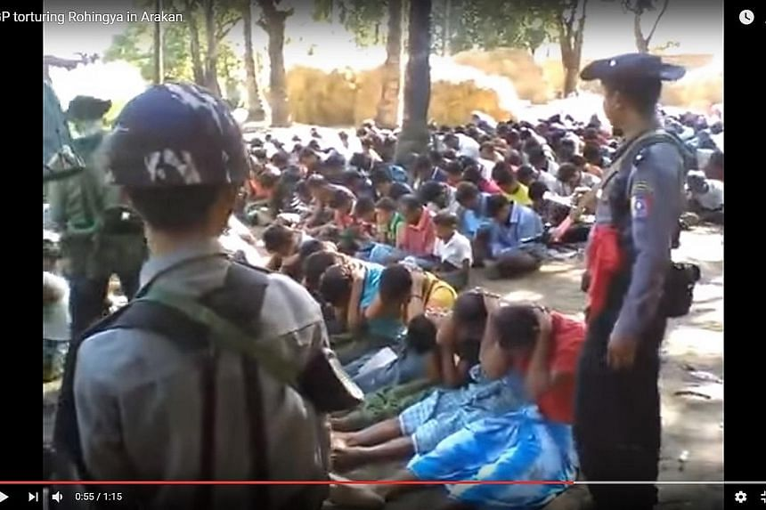 Police officers are seen hitting villagers seated in rows on the ground, hands behind their heads. This is the first time the government has pledged to take action over the abuse of Rohingya by security forces.