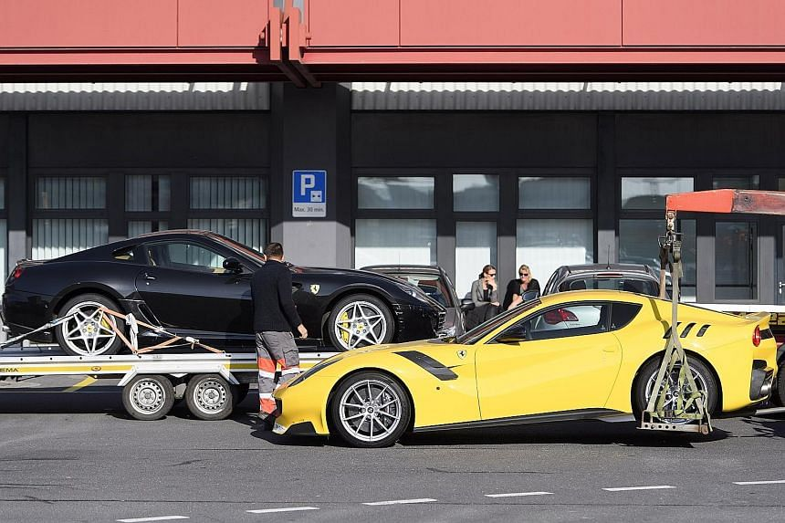 Two Ferrari cars (left) belonging to Obiang (above) being towed away by police at Geneva Airport, in Switzerland, on Nov 3.