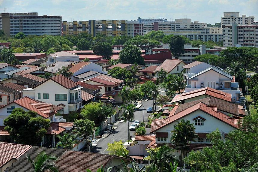 Private houses in Mayflower Gardens with HDB blocks in Ang Mo Kio in the background.