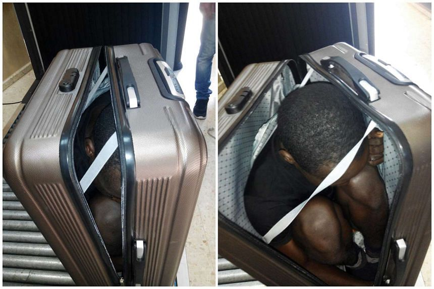 A handout photo by the Spanish Civil Guard on Jan 1 shows a composite image of two photos of a Sub-Saharan migrant inside a suitcase in Ceuta, the Spanish enclave in northern of Africa. The Spanish Civil Guard on Dec 30 Dec arrested a woman while she