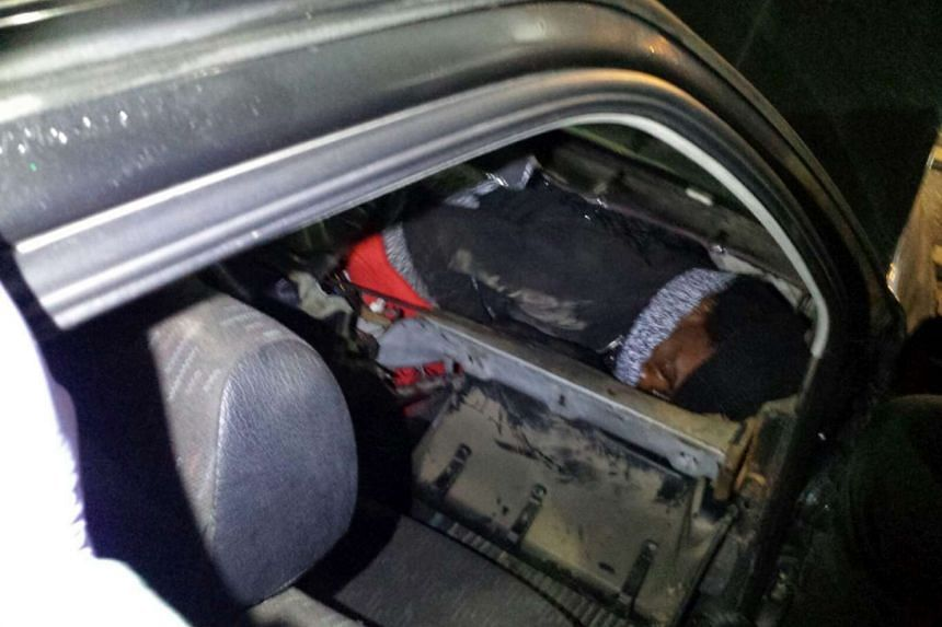 A handout photo by the Spanish Civil Guard showing a sub-Saharan migrant hidden in the dashboard of a car after being found by Civil Guard in Ceuta, Spanish enclave in northern Africa, 02 January 2017. Two sub-Saharan migrants, one man and a woman, w