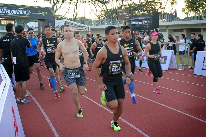 New Zealander Jason Lawrence (shirtless) won with a time of 58 minutes and 1 second, for the 14km obstacle race at the seventh edition of the Men's Health Urbanathlon on March 13, 2016.