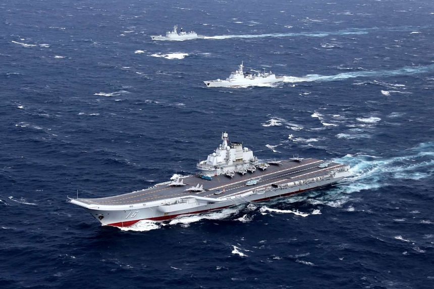 The Chinese aircraft carrier Liaoning with accompanying naval ships conducting a drill in the South China Sea in an undated photo taken in December 2016.
