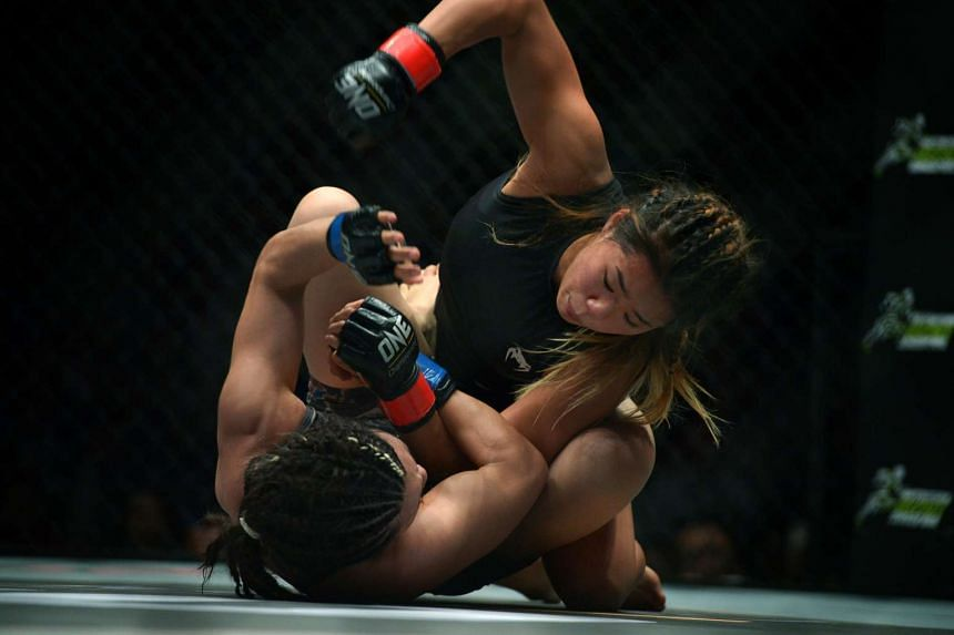 Angela Lee (above) battles Japan's Mei Yamaguchi during One Championship's first-ever women's title fight on May 6, 2016.