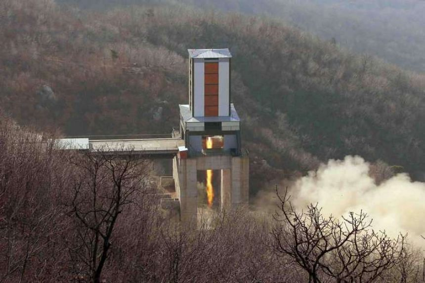 A new engine for an intercontinental ballistic missile (ICBM) is tested at a test site at Sohae Space Centre in Cholsan County, North Pyongan province in North Korea in this undated photo released by North Korea's Korean Central News Agency.