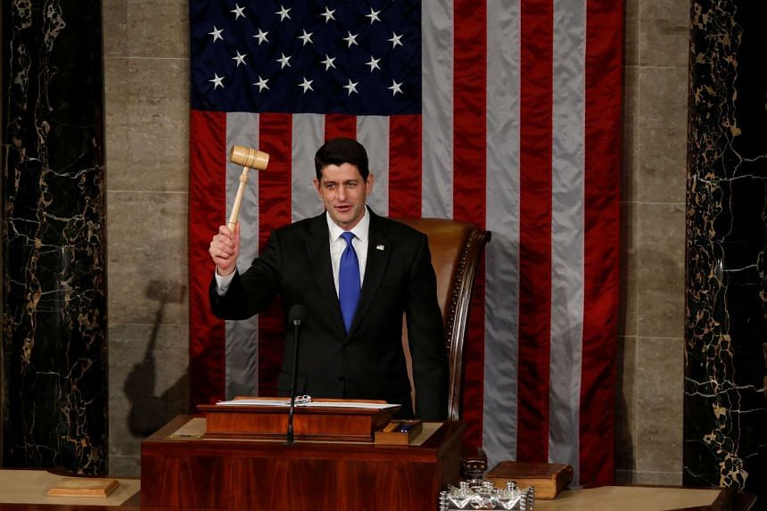 US House Speaker Paul Ryan (R-WI) raises the gavel during the opening session of the new Congress on Capitol Hill in Washington on Jan 3, 2017.