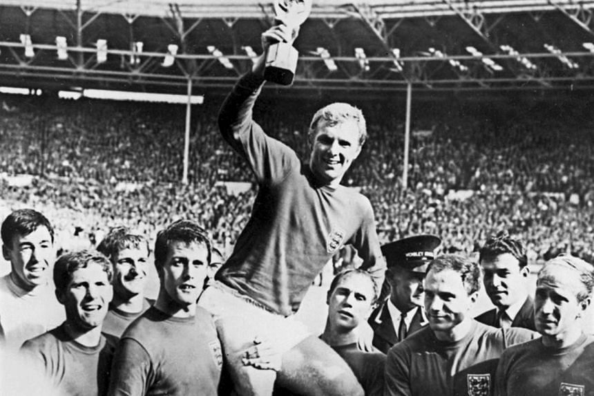 Bobby Moore holding the Jules Rimet trophy as he is carried by his teammates, following England's victory over Germany in the World Cup final on July 30, 1966.