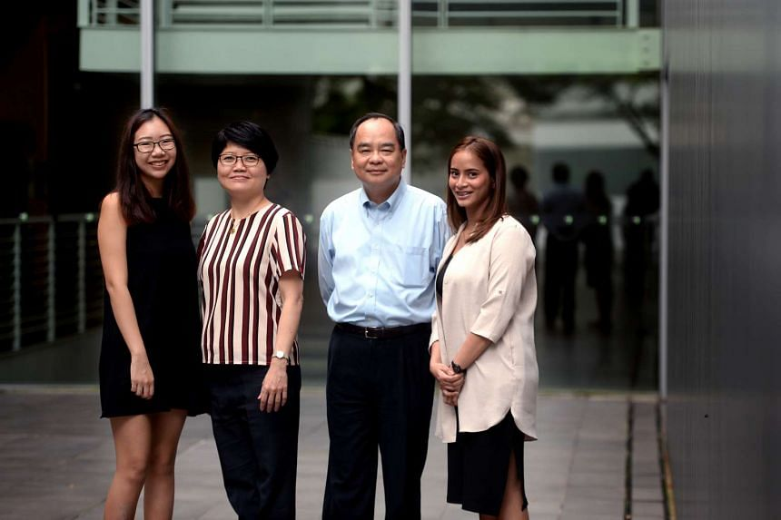 Graduates Pearlyn Mak (left) and Nadrah M. Heallmy, part of Republic Polytechnic's pioneer cohort for the SkillsFuture Earn and Learn Programme, with their mentors Ms Tan Yoke Hkeng and Mr Ng Kim Hung.