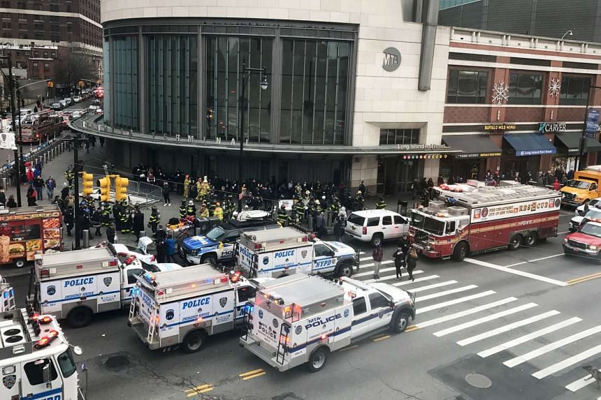 Emergency vehicles gather at the Atlantic Avenue Terminal after a commuter train derailed on Jan 4, 2016.