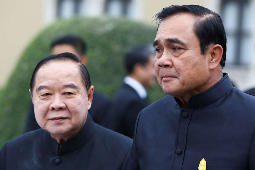 Thailand's Prime Minister Prayuth Chan-o-cha (right) and Deputy Prime Minister and Defence Minister Prawit Wongsuwan look on before a weekly cabinet meeting at Government House in Bangkok on Jan 4, 2017.