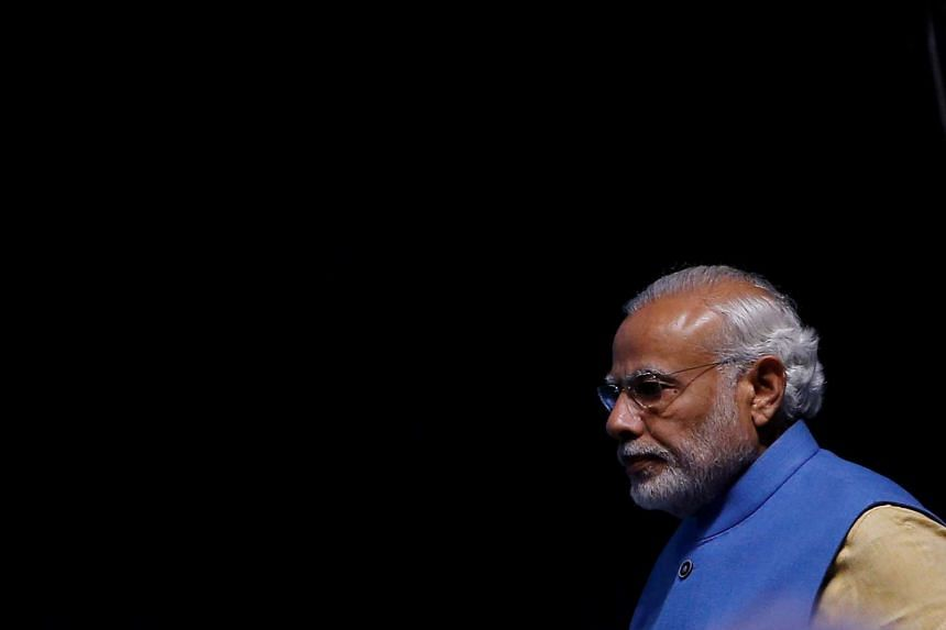 India's Prime Minister Narendra Modi arrives to launch a digital payment app linked with a nationwide biometric database in New Delhi on Dec 30, 2016.