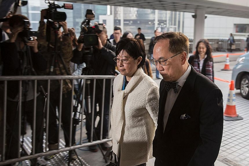 Tsang arriving at the High Court with his wife yesterday for the first day of his corruption trial. He pleaded not guilty to three charges of misconduct and bribery. The hearing is expected to last 20 days.