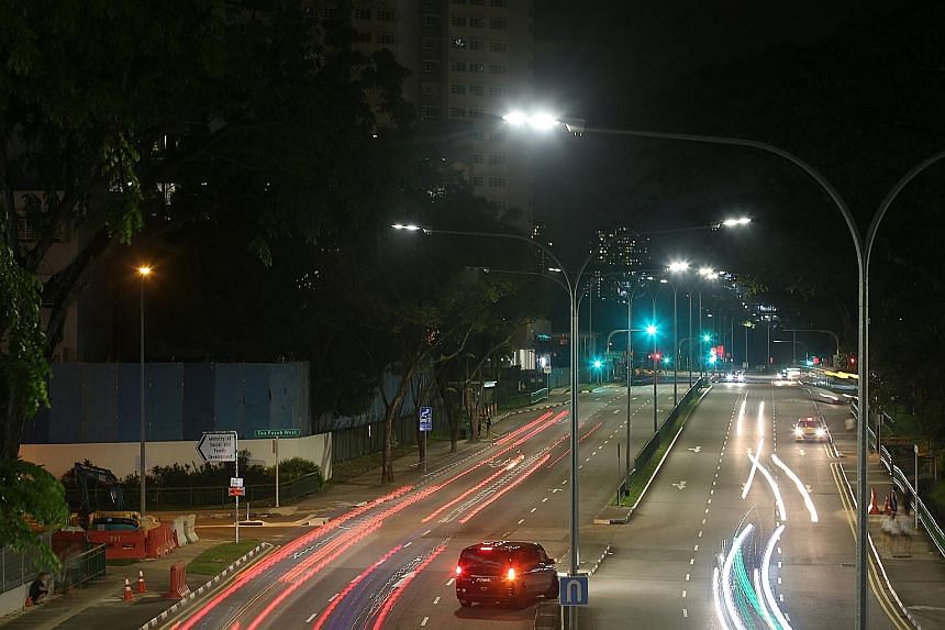 LED street lights, like these in Toa Payoh Lorong 1, emit white light and are about 25 per cent more energy efficient than the conventional high pressure sodium vapour lamps (far left).