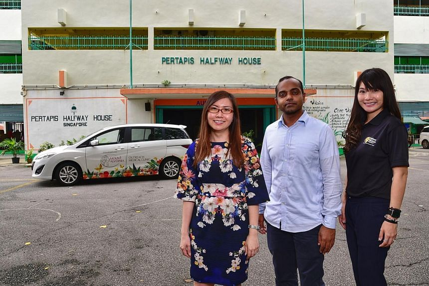 (From left) Mount Alvernia Hospital community outreach senior manager Anthea Neo, Pertapis Halfway House caseworker Thajudeen Muhd Equban and Yellow Ribbon Project secretariat Denise Chow say the mobile clinic brings primary care to ex-offenders who