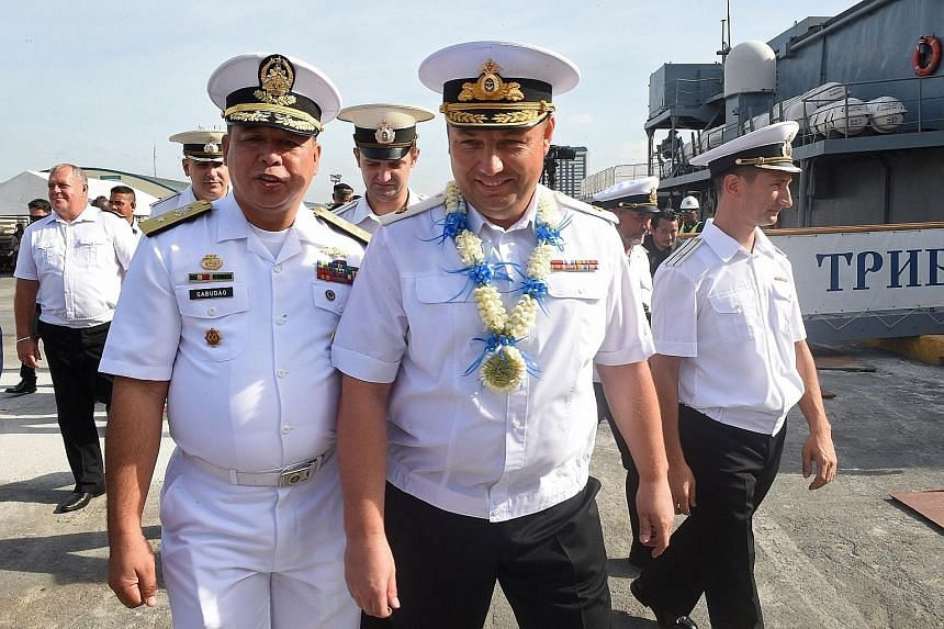 """Philippine Navy Commodore Francisco Gabudao Jr with Russia's Rear-Adm Mikhailov, after two ships arrived on a """"goodwill visit""""."""