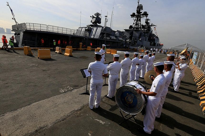 Band members from the Philippine Navy welcoming the anti-submarine destroyer Admiral Tributs, which docked in Manila yesterday. Philippine President Rodrigo Duterte has said he is willing to hold war games with Russia.