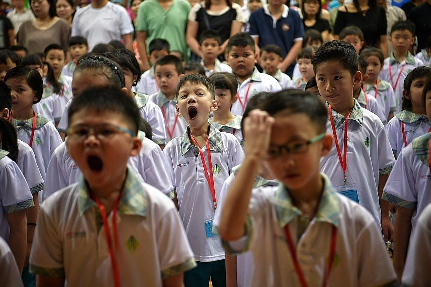 The new school year seems to have arrived a bit too early for some Primary 1 pupils at Westwood Primary School in Jurong West, seen here during morning assembly. They were among the 37,500 or so children across 190 schools who started primary school
