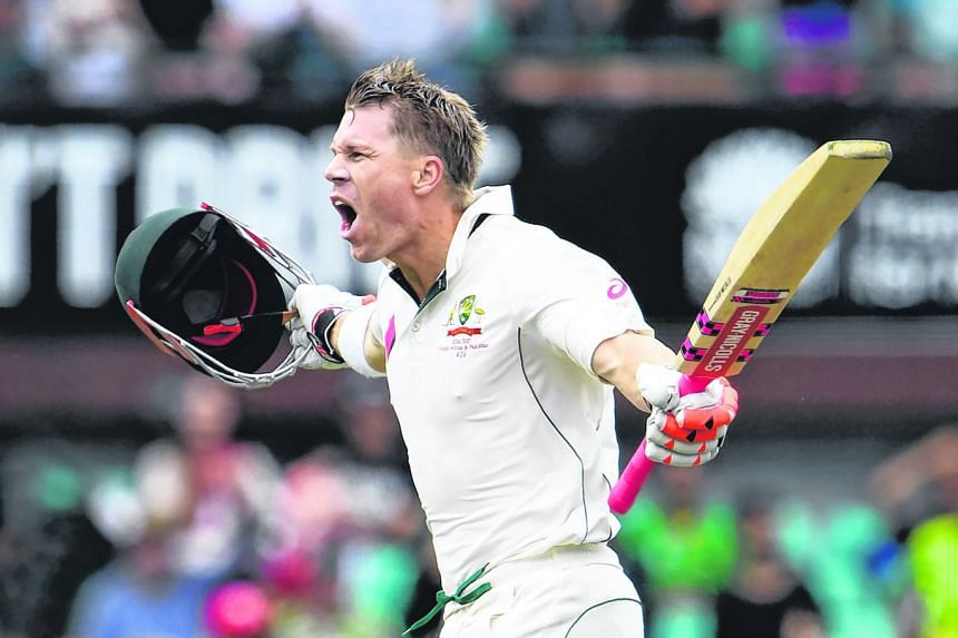 Australia's David Warner celebrates scoring a century against Pakistan during the first day of the third cricket Test match.