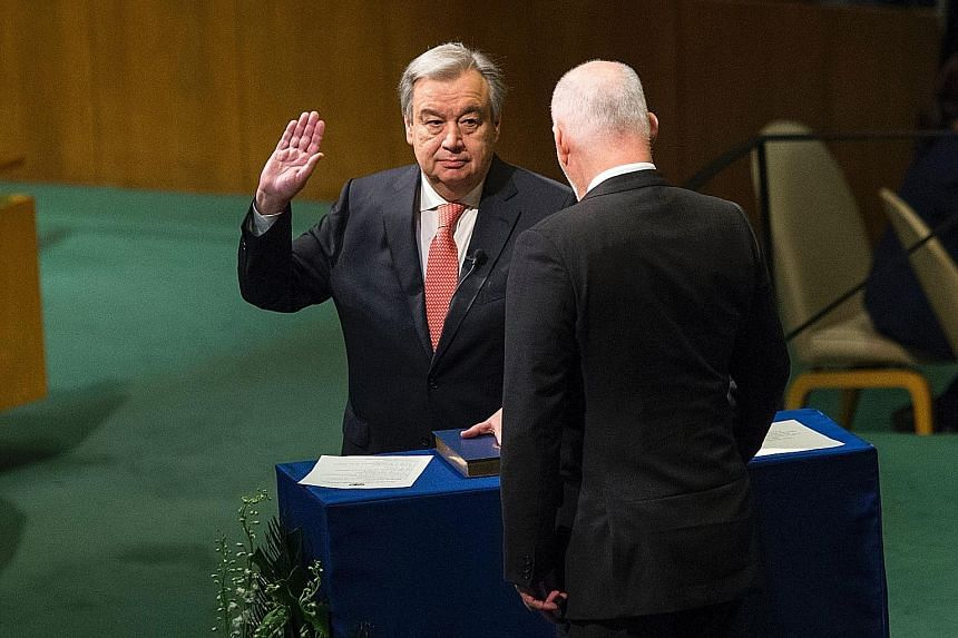 Mr Guterres (left) being sworn in as UN Secretary-General by the president of the General Assembly, Mr Peter Thomson, on Dec 12 last year at the United Nations in New York.