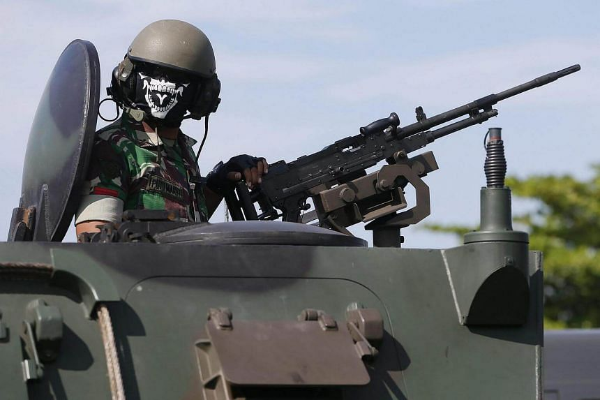 An Indonesian military officer operates an armoured vehicle in Denpasar, Bali, Indonesia on Dec 22, 2016.
