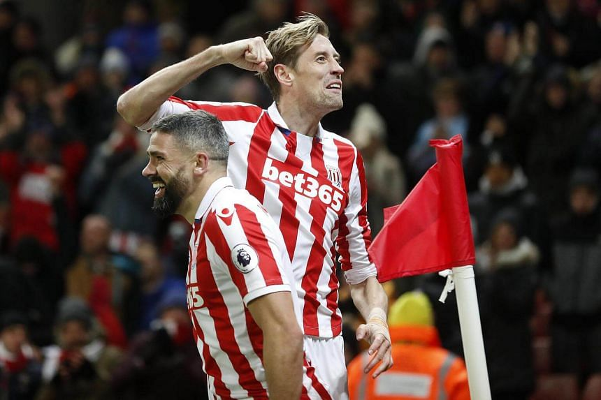Stoke City's Peter Crouch celebrates scoring their second goal with Jonathan Walters.