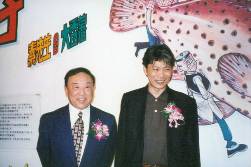 Alfonso Wong, the creator of Lao Fu Zi or Old Master Q comics, with his son Joseph Wong in 1995.