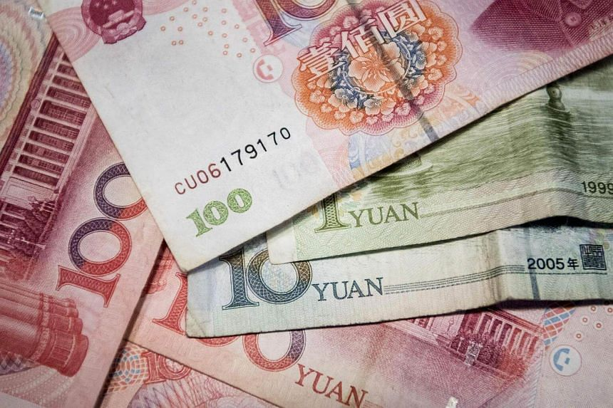 This photo illustration shows Chinese yuan notes in Beijing.