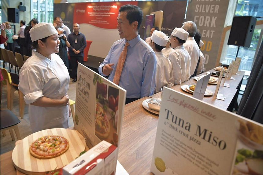 Education Minister Mr Ong Ye Kung witnessed the launch and MOU-signing between TP and NTUC Foodfare.