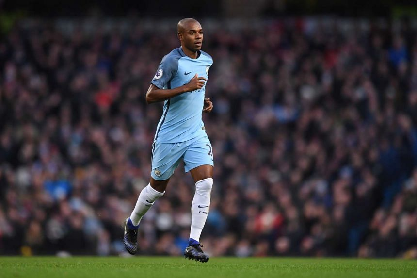 Manchester City's Fernandinho leaves the pitch after being sent off.