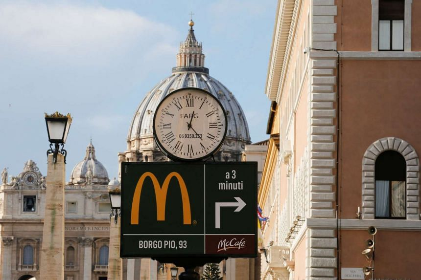 A McDonald's sign is seen at Via della Conciliazione street in Rome, Italy in front of Vatican City's St. Peter's Square on Jan 3, 2017.