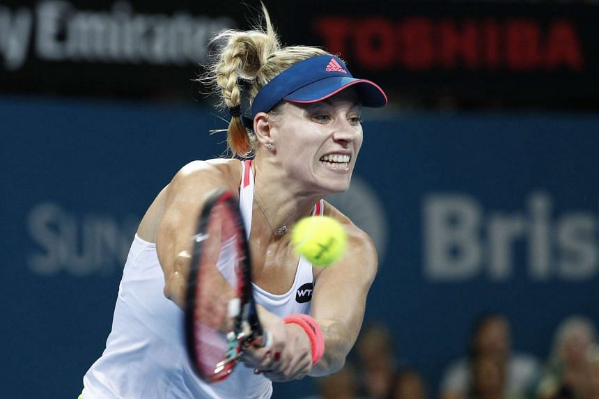 Angelique Kerber of Germany returns to Ashley Barty of Australia during their second round match.