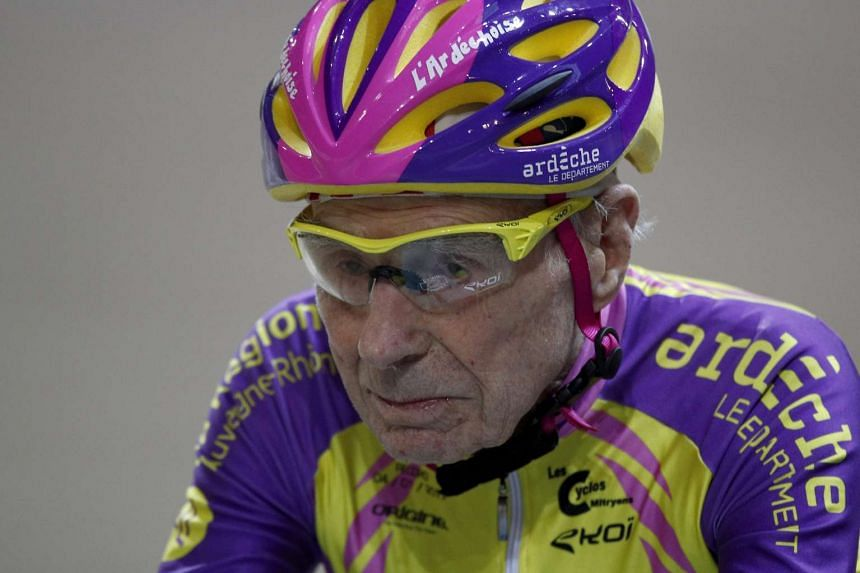 Marchand, aged 105, is a picture of concentration as he cycles in a bid to beat his record for distance cycled in one hour.