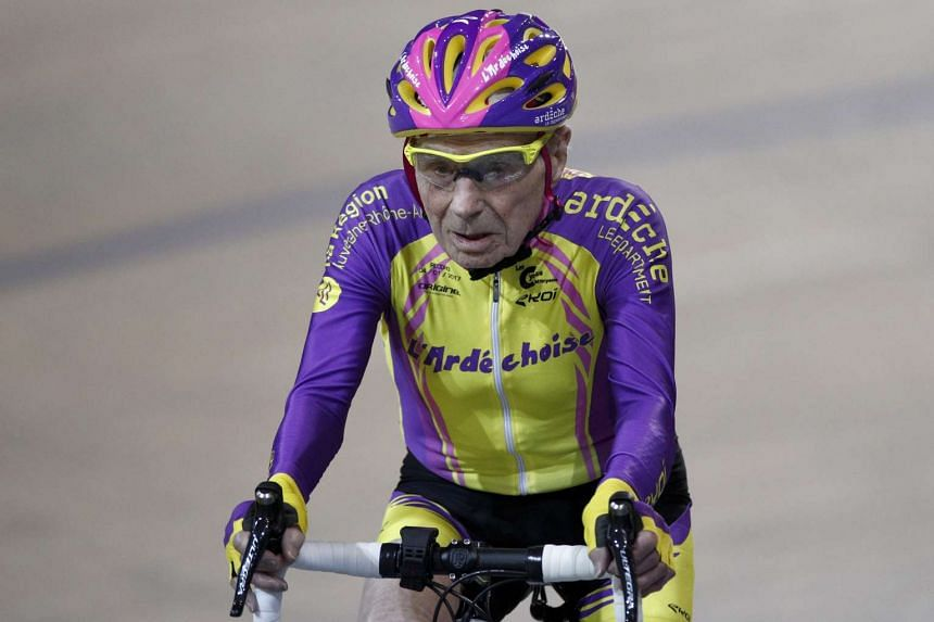 Marchand, aged 105, cycles in a bid to beat his record for distance cycled in one hour.