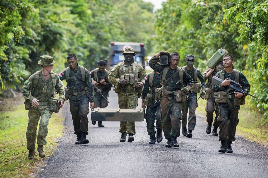 Australian and Indonesian soldiers train in Tully, Australia on Oct 10, 2014.
