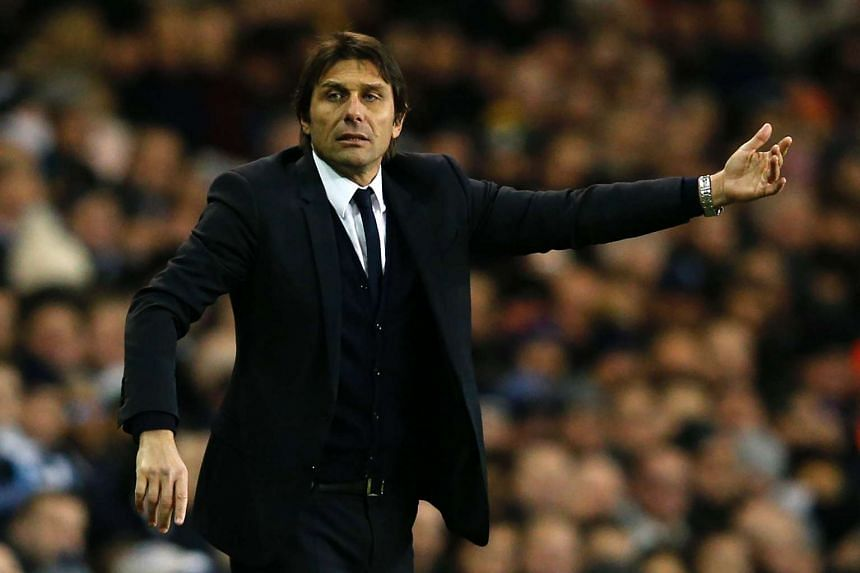 Chelsea's Italian head coach Antonio Conte gestures on the touchline during the English Premier League football match between Tottenham Hotspur and Chelsea at White Hart Lane in London, on Jan 4, 2017.