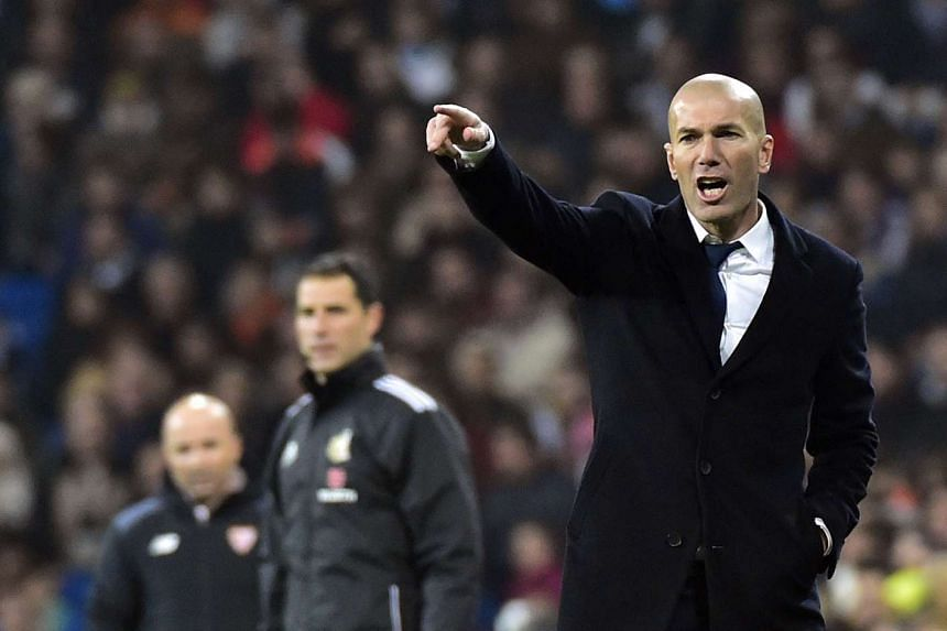 Real Madrid's French coach Zinedine Zidane gestures during the Spanish Copa del Rey (King's Cup) round of 16 first leg football match Real Madrid CF vs Sevilla FC at the Santiago Bernabeu stadium in Madrid on Jan 4, 2017.