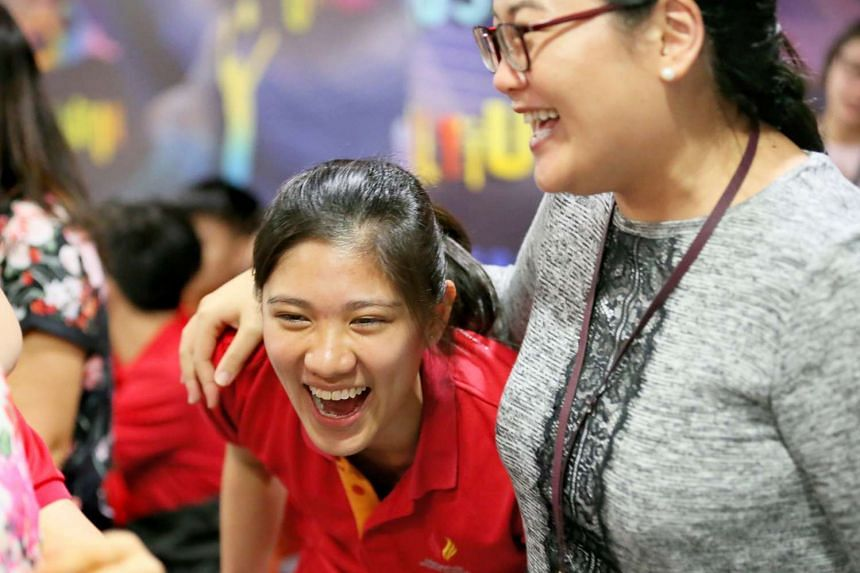 Sabrina Chau (left) reacts after collecting the IB results with mandarin teacher Oh Hui Min congratulating her.