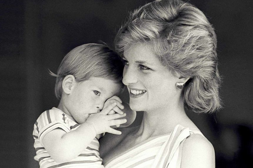 Britain's Princess Diana holds Prince Harry during a morning picture session at Marivent Palace in Mallorca, Spain on Aug 9, 1988.