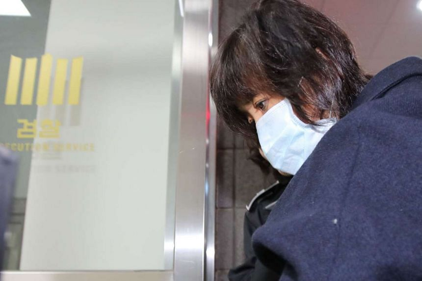 Choi Soon Sil arriving for questioning at a prosecutor's office in Seoul on Nov 1, 2016.