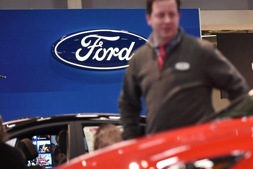 The Ford logo is seen at the 2016 Washington Auto Show in Washington, DC.