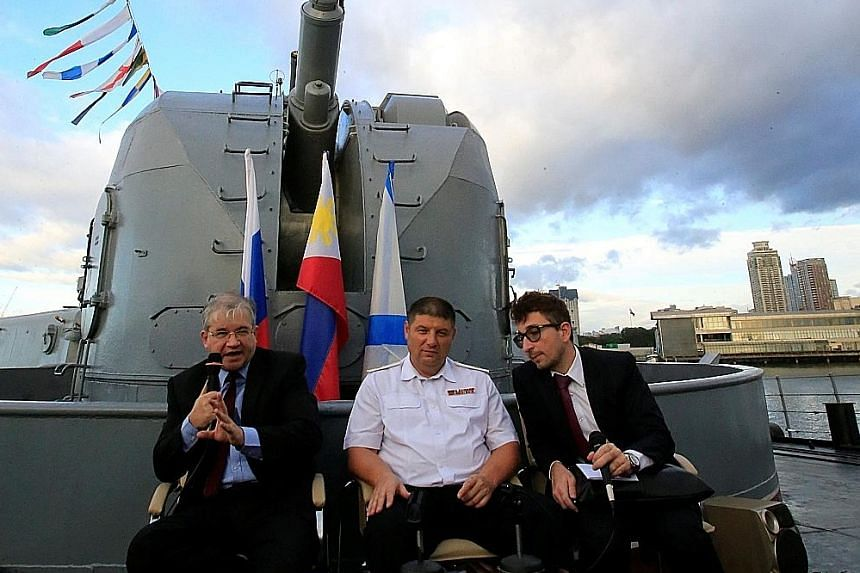 Russian Ambassador to the Philippines Igor Anatolyevich Khovaev (left) and Rear Admiral Eduard Mikhailov (centre) at their press conference on board the Russian destroyer docked in Manila yesterday.